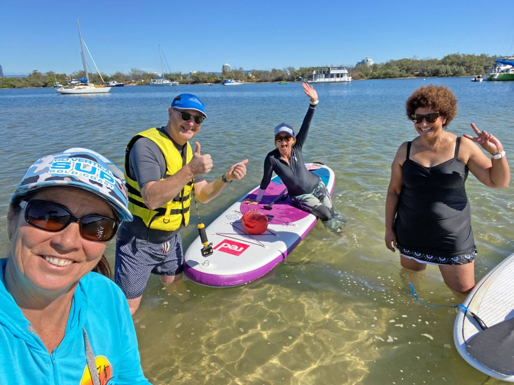 Adults having fun with Go Vertical SUP hire