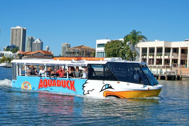 Aquaduck Duck Bus on the Gold Coast waters with customers waving out of the windows
