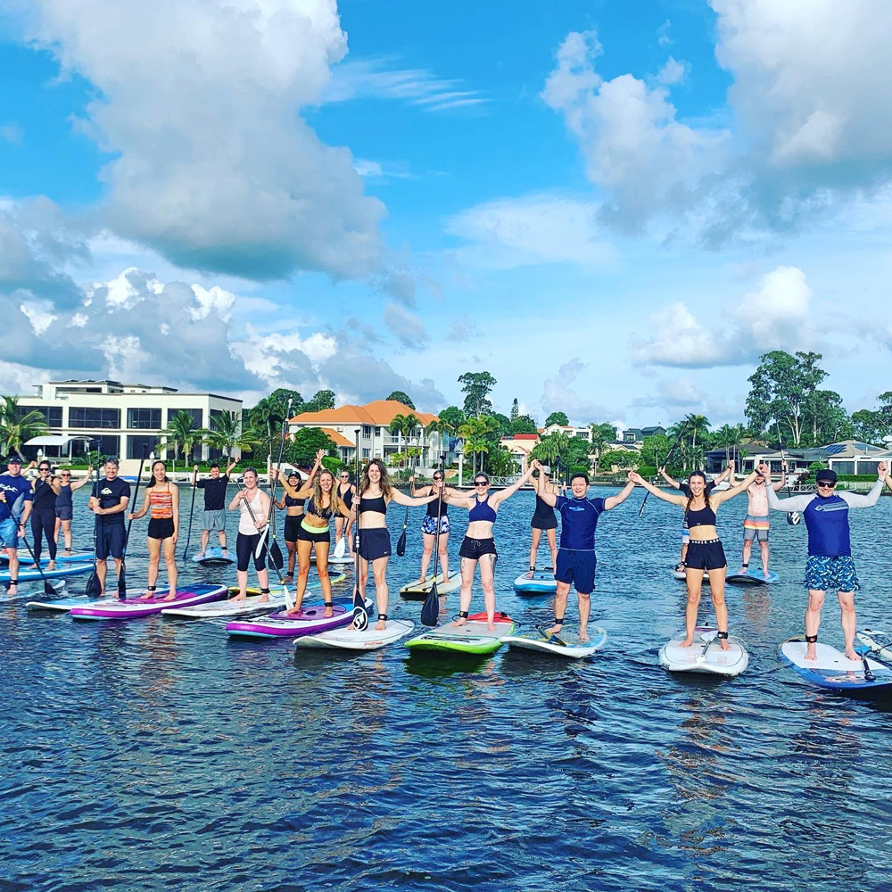 Large Group of people on Paddle Boards on the Gold Coast